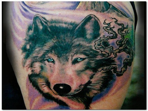 Colored Wolf Tattoo with Blue Eyes