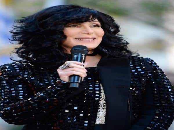 Cher with Layered Curly Shoulder Length Black Hair with Blue Highlights