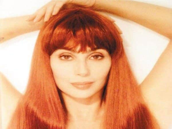 Cher with Long Straight Copper Colored Hair with Bangs
