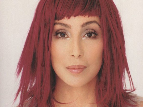 Cher with Straight Razor Cut Shoulder Length Red Hair