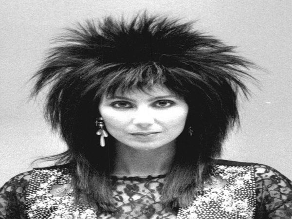 Cher with Layered Straight Hair with Spiky Top