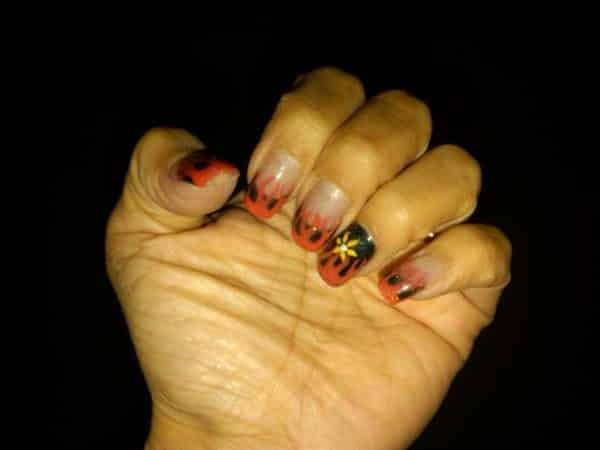 Clear Nails with Harley Davidson Flames and Single Black Nail with Yellow Flower