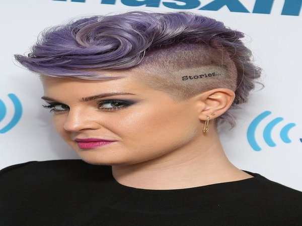 Kelly Osbourne Curly Purple Mohawk with Shaved Sides and Skull Tattoo
