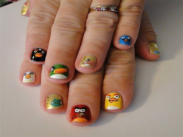 Angry Bird Nails with Gold Nails Decorated with Pig and More Angry Birds from Rio