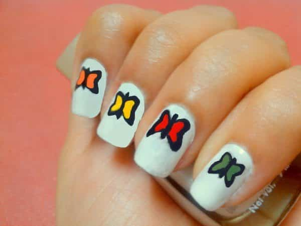 White Nails with Green, Orange, Red, and Green Butterflies
