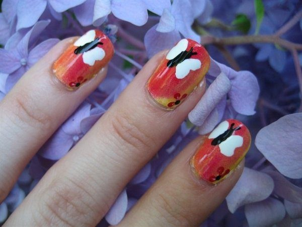 Orange and Yellow Nails with White and Black Butterflies and Red Flowers