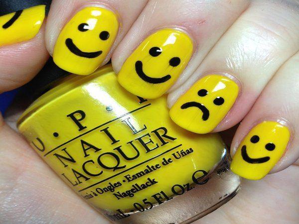 Yellow Happy and Sad Face Nails