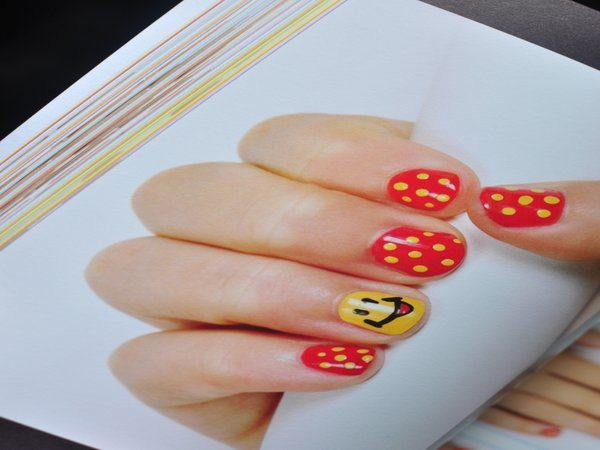 Red and Yellow Polka Dot Nails with Smiley Face
