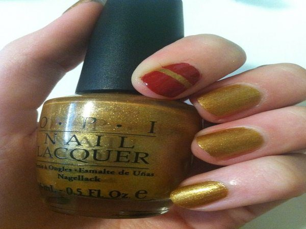 Gold Nails with Single Red Nail with Gold Stripe