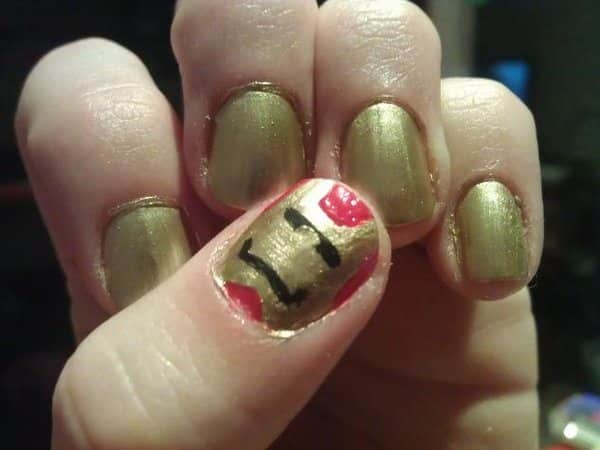 Gold Nails with Red Thumbnail Painted with Iron Man Mask