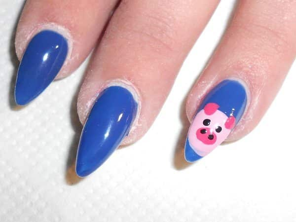 Blue Pointy Nails and Single Pink Piggie Nail