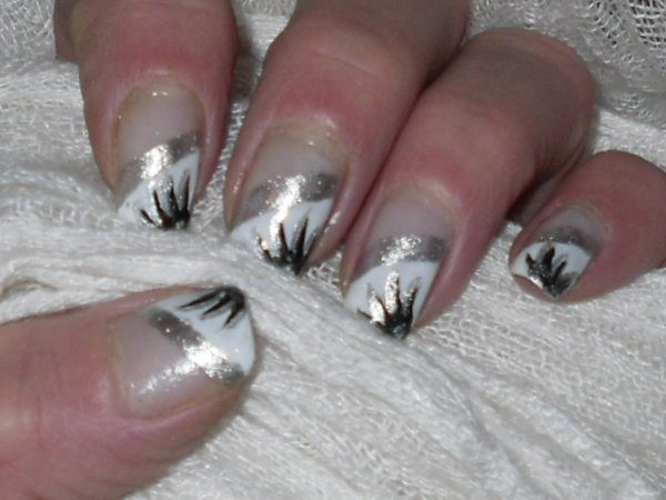 Silver and White Nails with Silver and Black Eyelash Design