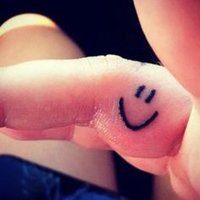 10 Scary and Silly Smiley Face Tattoo Designs