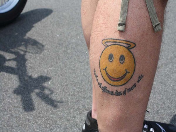 Calf Tattoo of Smiley Face Angel Plus Wording