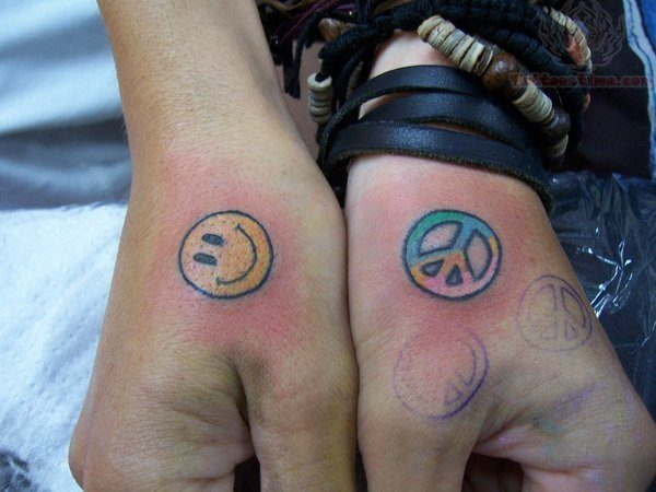 Back of Hand Tattoo of Smiley Face