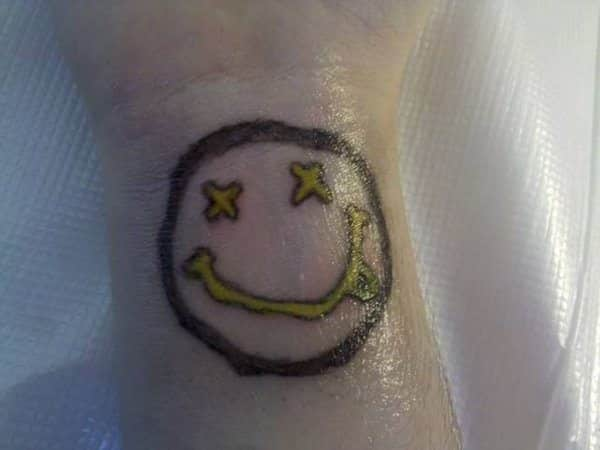 Smiley Face in Yellow with Tongue Sticking Out