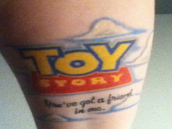 Toy Story Logo Tattoo with You Got A Friend In Me Words
