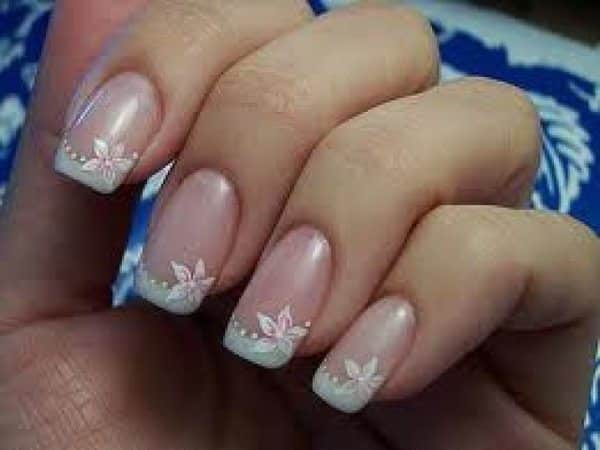 French Manicure Nails with White Flowers and Pearl Dots
