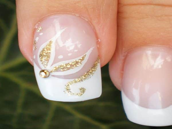French Manicure Nail with Gold Swirls and White Petals with Gold Stone Center