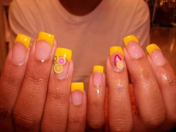 Clear Nails with Yellow Tips and Summer Fruit Decorations
