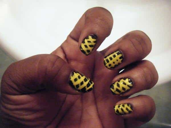Black Nails with Yellow Lace Up Design