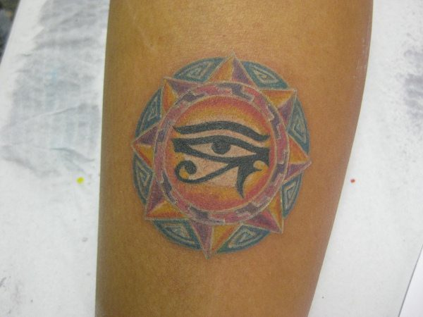 Round Colored Egyptian Eyes of Horus Tattoo within Egyptian Sun