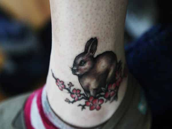 Brown Rabbit Tattoo with Red Flowers