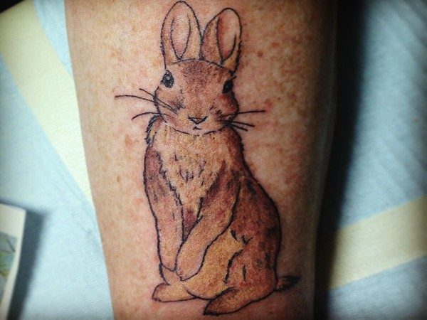 Cartoon Brown Rabbit Arm Tattoo