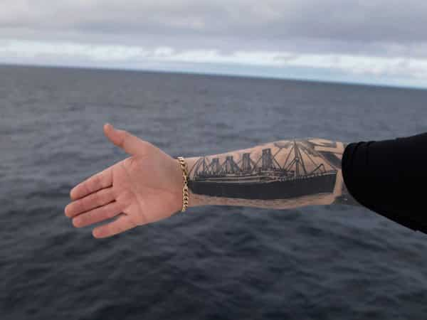 Black and White Titanic Ship Arm Tattoo
