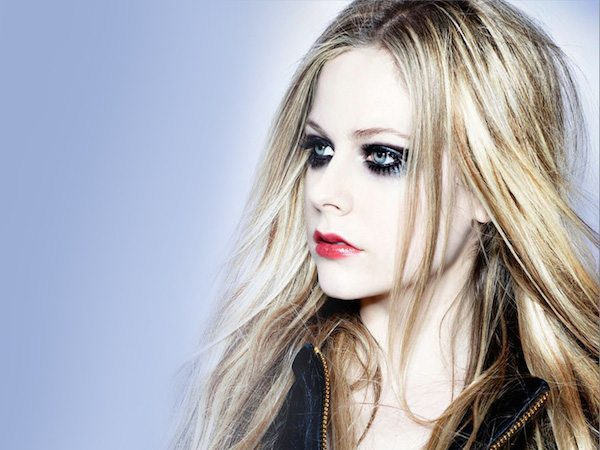 Avril Lavigne with Blond Hair and Dark Eye Makeup