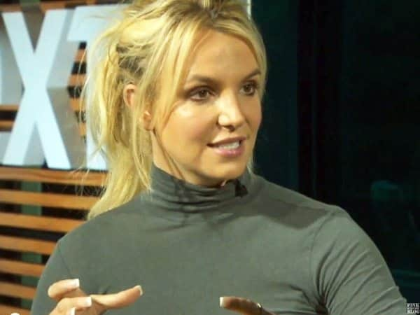 Britney Spears with Updo and Grey Turtleneck