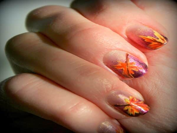 Plain Nails with Orange Leave on Purple Background