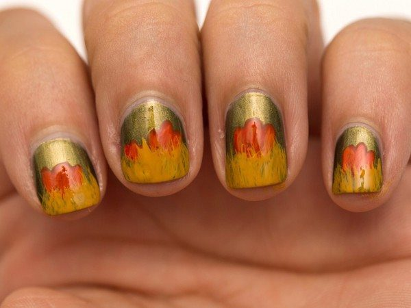 Gold Nails with Red Leaves and Yellow Tips