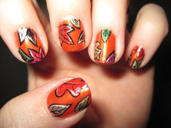 Orange Nails with Red, Brown, Green, Red, and Gold Leaves