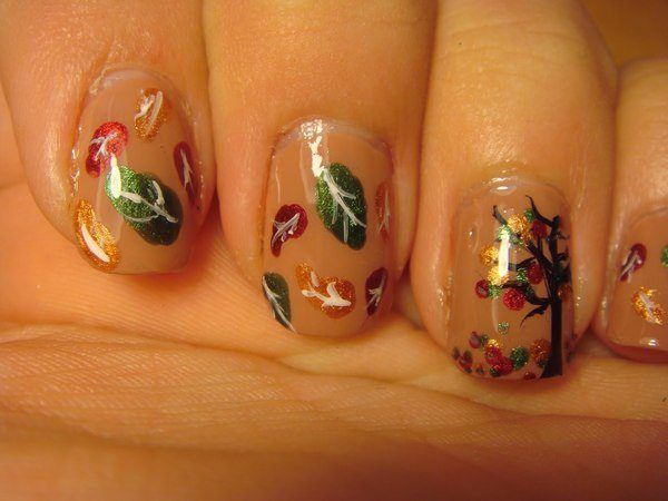 Beige Nails with Gold, Green, and Red Leaves