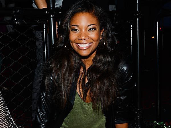 Gabrielle Union Smiling and Wearing Leather Jacket