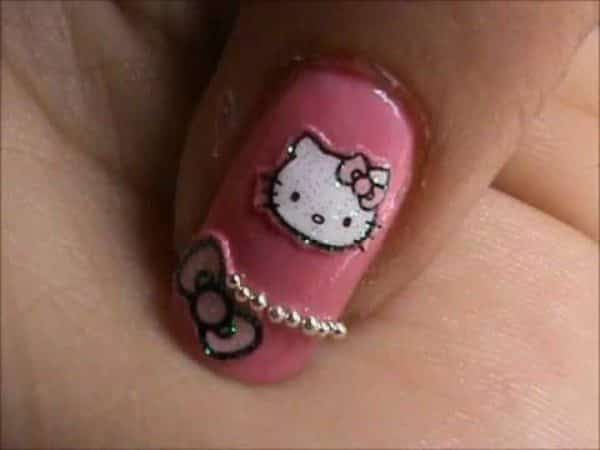 Pink Nails with Hello Kitty, a Pink Ribbon, and Pink Pearls