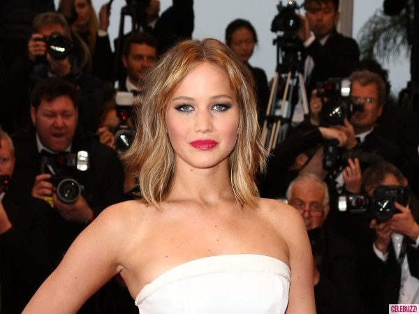 Jennifer Lawrence with Long Blond Hair and White Strapless Dress