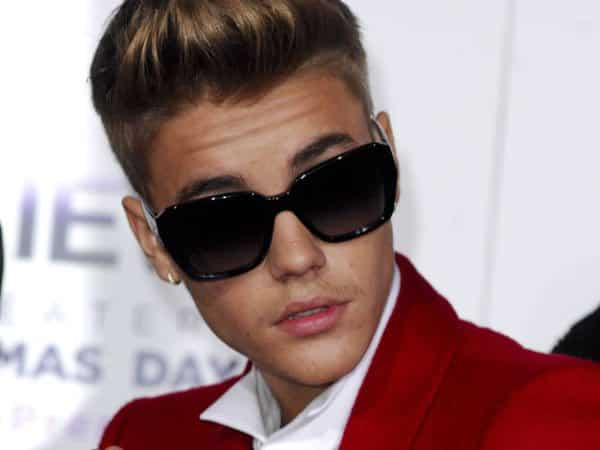 Justin Bieber with Sunglasses and Curled Back Bangs