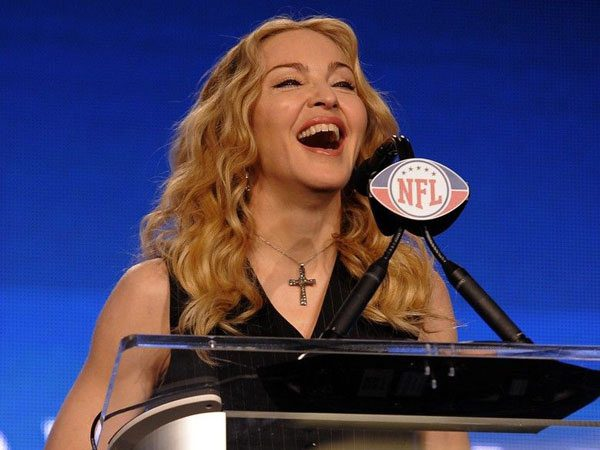 Madonna At NFL Press Conference with Curly Blond Hair
