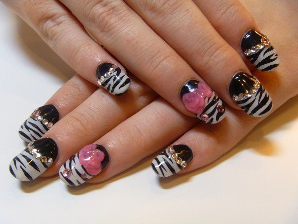 Black Nails with White Zebra Print and Decorated with Rhinestones and Pink Flowers
