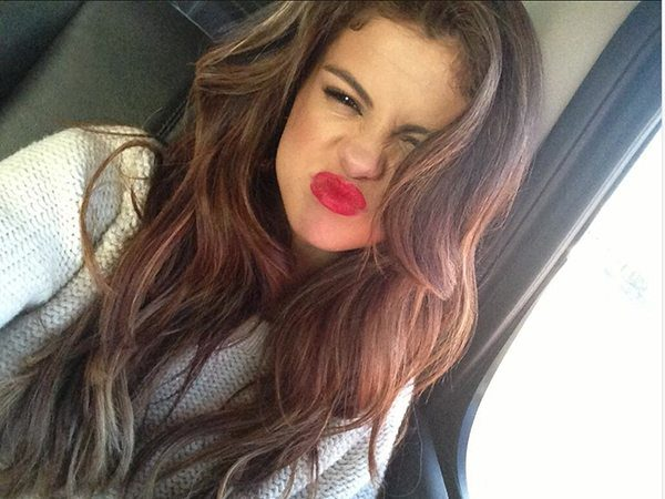 Sideways Selena Gomez with Curly Hair Making Face