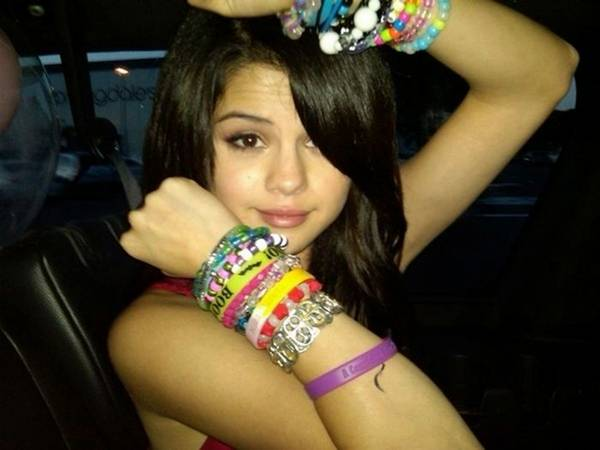 Selena Gomez with Many Bracelets