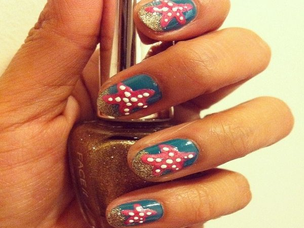 Blue Nails with Gold Glitter Tips and Red Starfish
