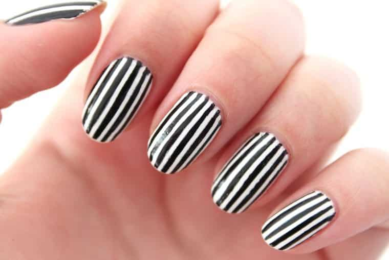 10 stupendously striped nail designs white and black skinny striped nails prinsesfo Images