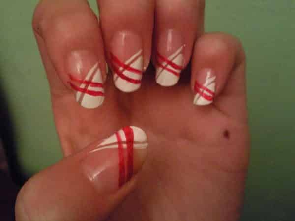 White Nails With Red Stripes Forming an X