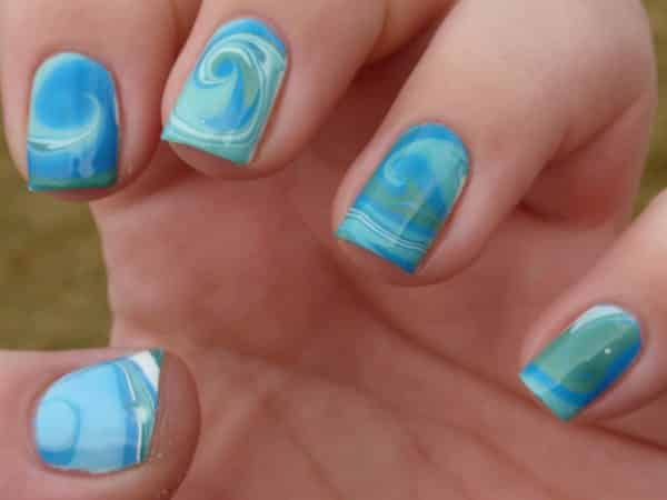 Blue Nails with White, Blue and Green Waves and Marble Designs