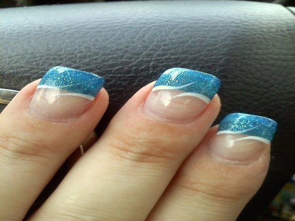 Plain Nails with Blue Glitter Tips and Wave Designs