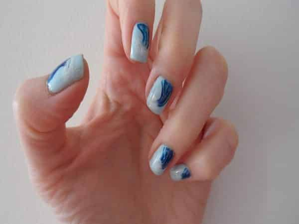 Light Blue Nails with Wave Designs