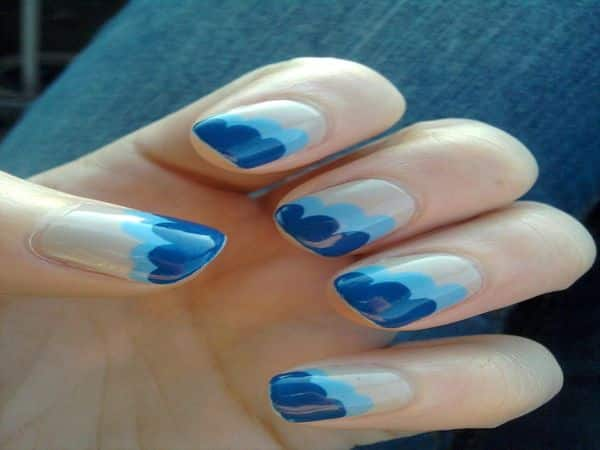 Tan Nail with Light Blue and Dark Blue Wave Designs